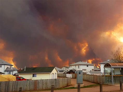 'Homes are on fire as we speak': Tens of thousands flee as