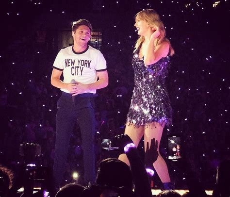 Taylor Swift Brings Out Niall Horan & Robbie Williams For