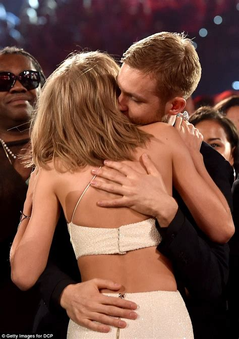 Taylor Swift Kisses Calvin Harris in Her Sexy Jumpsuit at