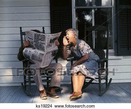 Stock Photo of 1970S Elderly Couple Porch Rocking Chairs