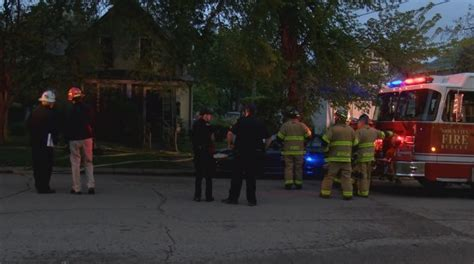 Two people hospitalized after being trapped in house fire